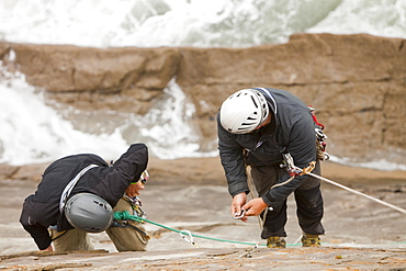 Climbers on a sea cliff climb on Baggy Point near Croyde in north Devon, England, United Kingdom, Europe