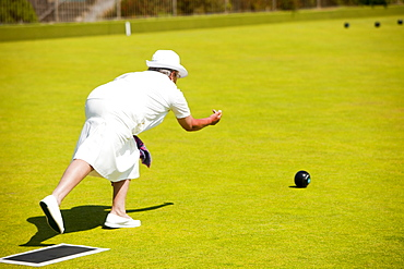 Woman playing bowls at Penzance in West Cornwall, England, United Kingdom, Europe