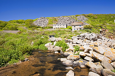 Houses at Lamorna Cove, overshadowed by boulders from an old quarry, Cornwall, England, United Kingdom, Europe