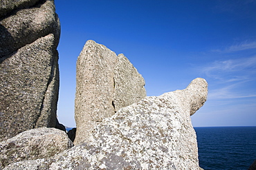 Granite sea cliffs at Logan Rock Headland in Porthcurno, Cornwall, England, United Kingdom, Europe