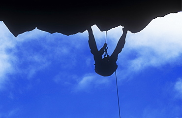 A man abseiling down a cliff in the Lake District, Cumbria, England, United Kingdom, Europe