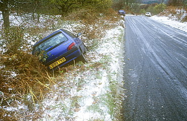 A car skidded and crashed on an ice road in Eskdale, Cumbria, England, United Kingdom, Europe