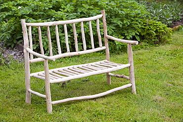 A handmade garden bench in Sprint Mill Garden, near Kendal, Cumbria England, United Kingdom, Europe