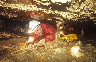A caver in Easegill Caverns in the Yorkshire Dales, Yorkshire, England, United Kingdom, Europe