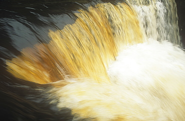 Water stained with peat in Swaledale, Yorkshire Dales, Yorkshire, England, United Kingdom, Europe