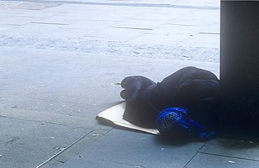 A homeless woman sleeping on a London street, England, United Kingdom, Europe