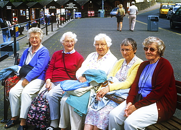 Old women on a bench in Bowness on Windermere, Lake District, Cumbria, England, United Kingdom, Europe