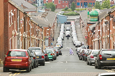 Cars parked on a street in the Asian area of Blackburn, Lancashire, England, United Kingdom, Europe