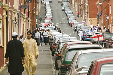 Muslims off to Friday prayers in the Asian area of Blackburn, Lancashire, England, United Kingdom, Europe