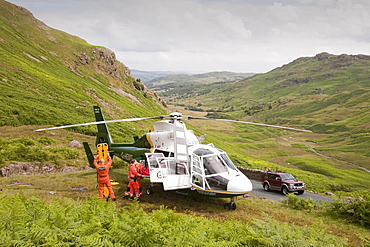Paramedics from the Great North Air Ambulance and members of Langdale/Ambleside Mountain Rescue Team evacuate an injured man who fell into Wrynose Beck, Lake District, Cumbria, England, United Kingdom, Europe
