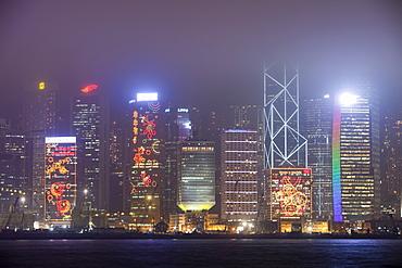 Office blocks lit up at night in Hong Kong, China, Asia