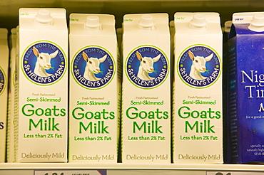 Goats milk for sale on supermarket shelves, Cumbria, England, United Kingdom, Europe