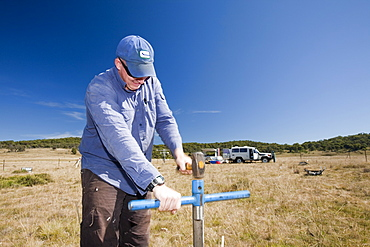 Robert Simpson takes soil samples to measure the level of methanotropic bacteria during an experiment by scientists from Sydney University, in the Snowy mountains, New South Wales, Australia Pacific