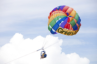 Tourists parasailing off Green Island on The Great Barrier Reef near Cairns in Queensland, Australia, Pacific