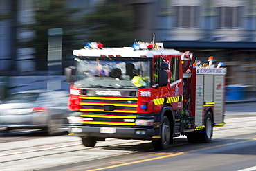 A Melbourne fire engine responding to an emergency in the city centre, Melbourne, Victoria, Australia, Pacific