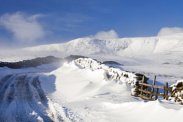 Red Screes and the Kirkstone Pass road blocked by snow in the Lake District, Cumbria, England, United Kingdom, Europe
