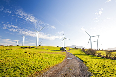 A wind farm on the outskirts of the Lake District with Skiddaw behind, Cumbria, England, United Kingdom, Europe