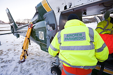 Air Ambulance paramedics and Mountain Rescue team members evacuate an injured walker who had fallen and injured his back in the Langdale Valley, Lake District, Cumbria, England, United Kingdom, Europe