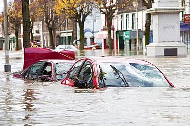 Flooded cars on Cockermouth's Main Street, Cumbria, England, United Kingdom, Europe