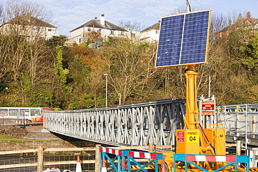 Footbridge installed by the army to reconnect the two halves of the town. and named the Barker Crossing after PC Bill Barker who lost his life when Workington's main road bridge was destroyed, Workington, Cumbria, England, United Kingdom, Europe