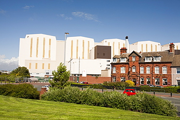 BAE systems buildings overshadowing old terraced houses in Barrow in Furness, Cumbria, England, United Kingdom, Europe