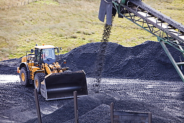 A conveyor belt taking coal from the Glentaggart open cast coal mine to a roadhead for onward transport by road in Lanarkshire, Scotland, United Kingdom, Europe