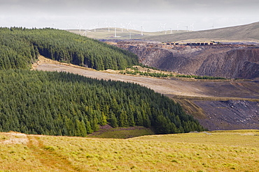 Climate change heaven and hell, showing The Hagshaw Hill wind farm above the Spireslack open cast coal mine in Lanarkshire, Scotland, United Kingdom, Europe
