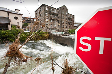The flooding River Leven that empties Lake Windermere, swept the parapets off the bridge at Backbarrow, resulting in its closure, Cumbria, England, United Kingdom, Europe