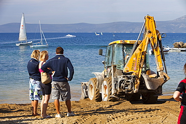 Repairing storm damage by adding new sand to a beach in Teos, Western Turkey, Eurasia