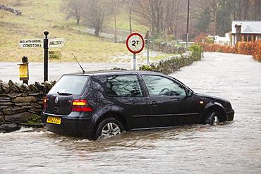 A flooded car in Ambleside, Lake District, Cumbria, England, United Kingdom, Europe