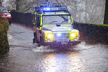 A Langdale Ambleside Mountain Rescue Team responding to calls for help from flooded motorists, Ambleside, Lake District, Cumbria, England, United Kingdom, Europe