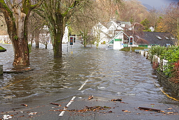 Lake Windermere at its highest ever recorded level and flooded buildings in Ambleside, Lake District, Cumbria, England, United Kingdom, Europe