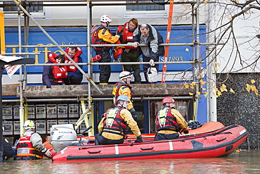Rescue workers rescuing flood victims from their houses on the Main Street of Cockermouth, Cumbria, England, United Kingdom, Europe