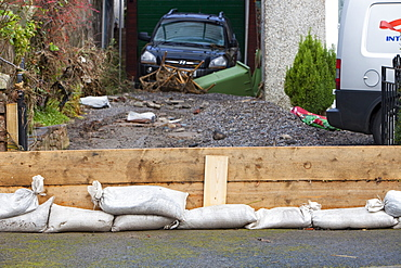 A householder's attempt to hold bavk the flood waters near Cockermouth's Main street, after the water receded, Cumbria, England, United Kingdom, Europe