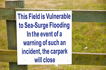 A sign about coastal flooding at Wells next the Sea, Norfolk, England, United Kingdom, Europe