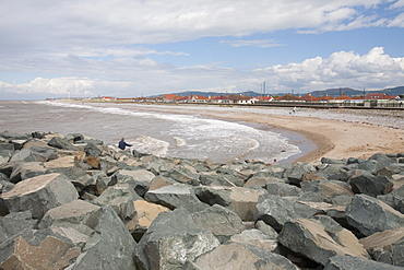Rocks placed to re-inforce the sea wall in the area of the North Wales coast between Prestatyn and Abergele which was reclaimed from an ancient salt marsh, and is flat, low lying and susceptible to coastal flooding, Wales, United Kingdom, Europe