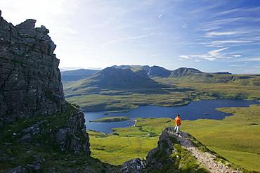 A climber on Stac Pollaidh in Assynt, Sutherland, Scotland, United Kingdom, Europe