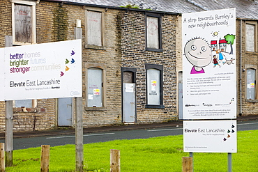 Boarded up terraced houses that have been compulsorily purchased for demolition in the Burnley Wood area of Burnley, Lancashire, England, United Kingdom, Europe