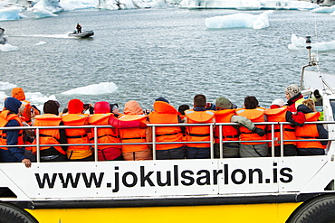 Tourists riding in an amphibious truck at the Jokulsarlon ice lagoon, one of the most visited places in Iceland, Polar Regions