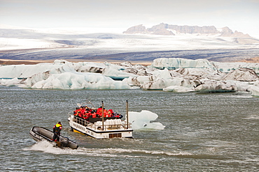 Tourists taking a boat trip to get close to the icebergs, Jokulsarlon ice lagoon, one of the most visited places in Iceland, Polar Regions