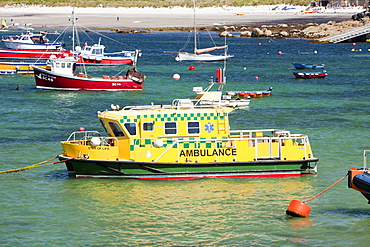 An ambulance boat moored in Hugh Town harbour on St. Mary's, Isles of Scilly, United Kingdom, Europe