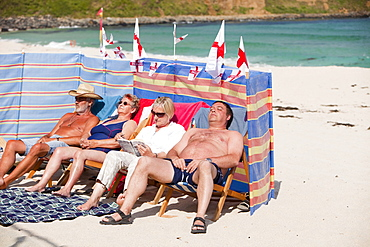 World cup England supporters sunbathing on the beach at St. Ives, Cornwall, England, United Kingdom, Europe