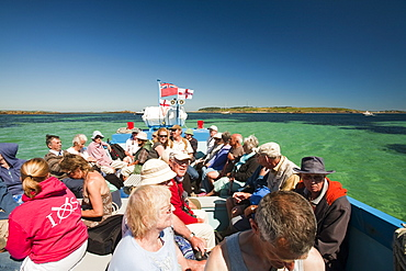 Tourists on a small passenger boat from Tresco to St. Mary's, Isles of Scilly, United Kingdom, Europe