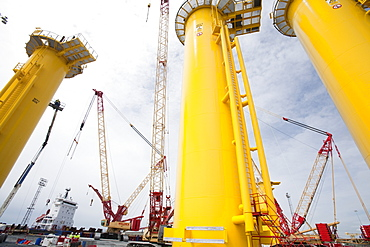 Transition pieces on the quayside for the Walney Offshore Windfarm project, located 15km off Barrow in Furness in Cumbria, England, United Kingdom, Europe