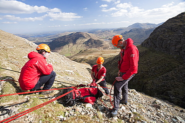 Members of Langdale Ambleside Mountain Rescue set up a belay to lower a team member into Dungeon Ghyll, to rescue injured stranded walkers, Langdale, Lake District, Cumbria, England, United Kingdom, Europe