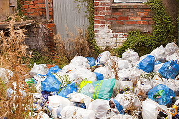 Rubbish piled high behind condemned houses in Barrow in Furness, Cumbria, England, United Kingdom, Europe