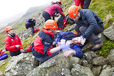 Members of the Langdale Ambleside Mountain Rescue Team, train in first aid using realistic actors from the Casualties Union, on Red Screes in the Lake District, Cumbria, England, United Kingdom, Europe
