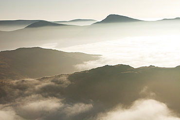 A temperature inversion with valley mist over Red Screes near Ambleside looking towards the Kentmere Fells, Lake District National Park, Cumbria, England, United Kingdom, Europe
