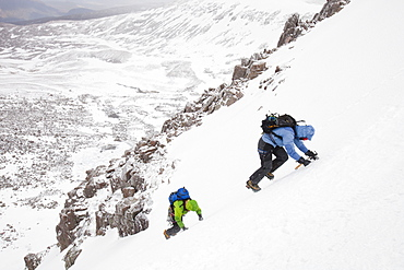 Mountaineers descending the Goat track on the Cairngorm plateau, above Corie an Sneachda, Cairngorm mountains, Scotland, United Kingdom, Europe