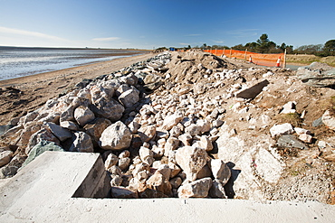 Repairing the sea wall damaged and breached by storms on the coast road near Barrow in Furness, between Rampside and Baycliff, Cumbria, England, United Kingdom, Europe